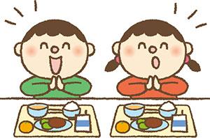 給食を食べる子供の画像